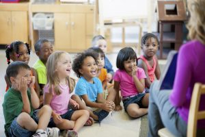 Preschool children in a classroom for story time.