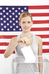Portrait of young woman voting
