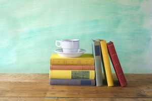stack of books with a cup of coffee, free copy space. Special edition only available here.