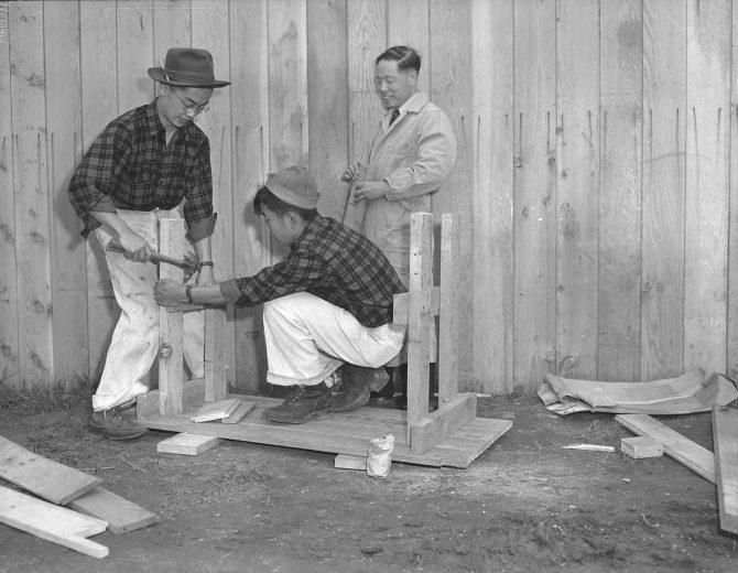 Image of men building furniture