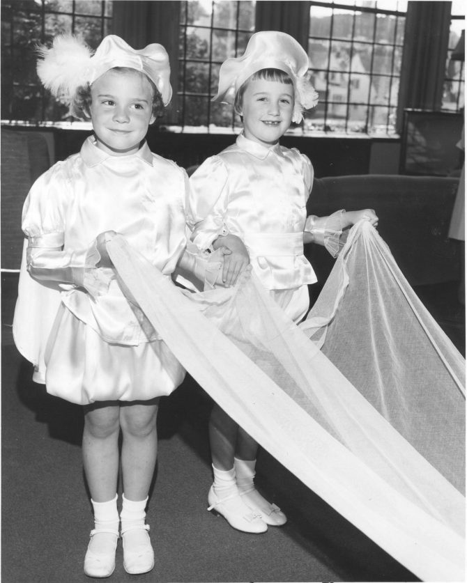 Image of two little girls holding up a train