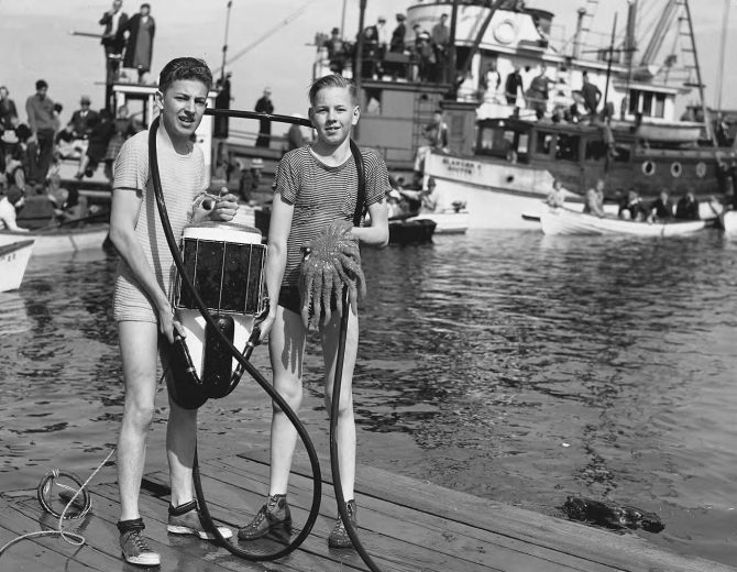 Image of two boys with a diver's helmet