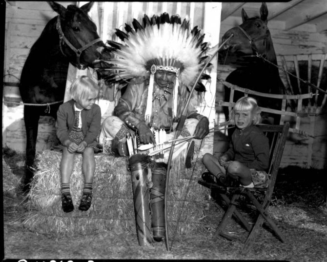 Image of an Indian Chief and two children