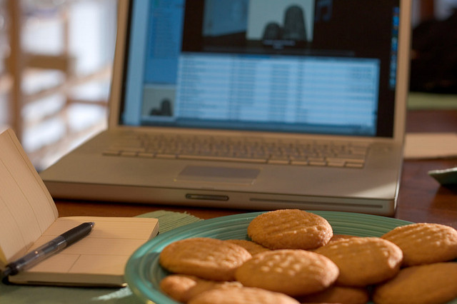 Image of a Plate of Cookies in Front of a Computer