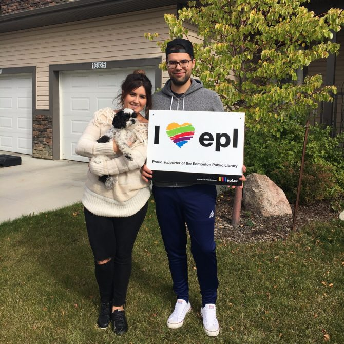 """Image of EPL supporters with an """"I (heart) EPL"""" lawn sign"""