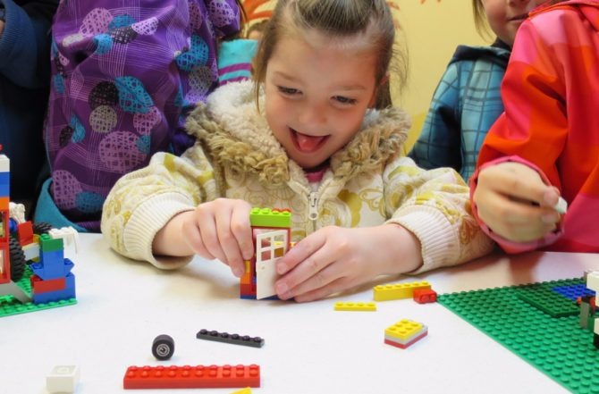 Image of a child playing with LEGO