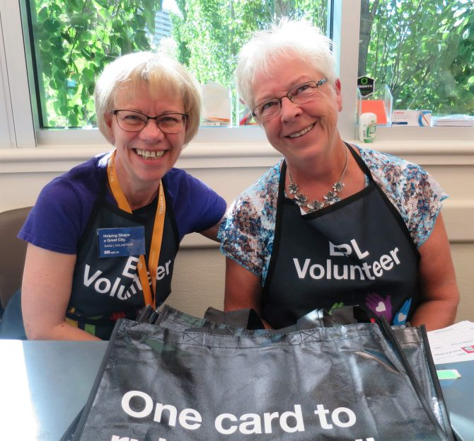 Volunteer cashiers at library book sale