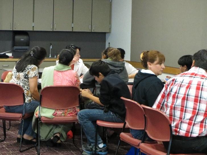 Adults working together at an ESL workshop