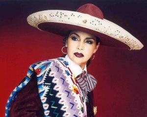 Aida Cuevas, a female mariachi singer, in traditional mariachi dress.