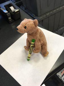 Teddy bear with a crayon