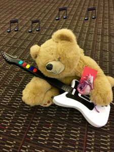 Teddy bear playing guitar