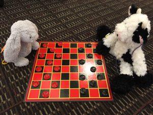 Stuffed animals play checkers