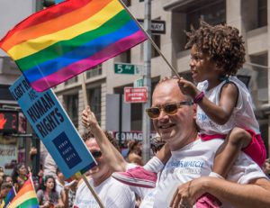 Father and daughter at NYC Gay Pride 2013. Source: Bob Jagendorf, Flickr