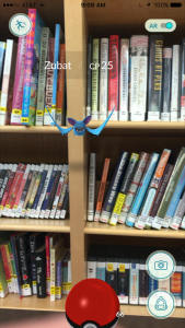 Zubat flying in front of the bookshelves on the bookmobile.