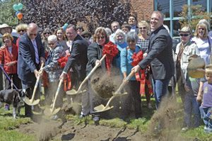 City and county officials with shovels in hand break ground on the new Half Moon Bay Library. Source: Samantha Weigel, Daily Journal