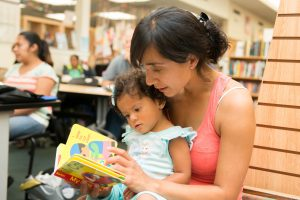Mother reading to her child. Source: Becky Ruppel Photography