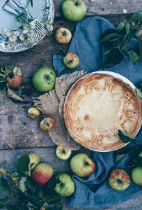Photo of a table Setting with pie. Source: Annie Sprat, Unsplash CC0