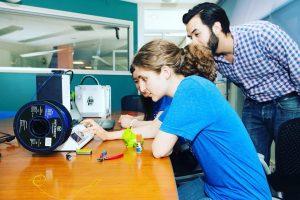 Staff and Interns using 3D printer.