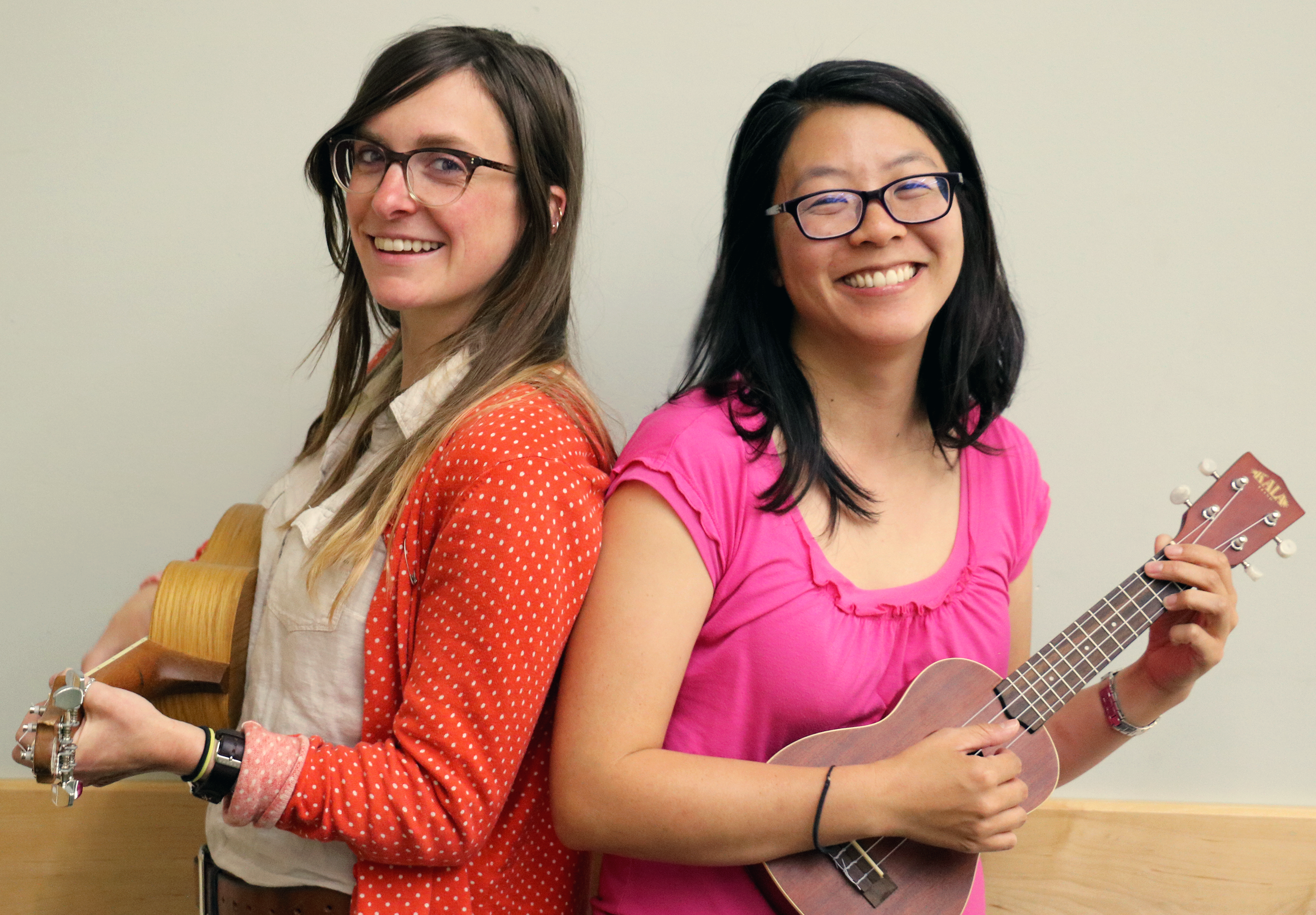 Library staff posing with our new ukuleles.