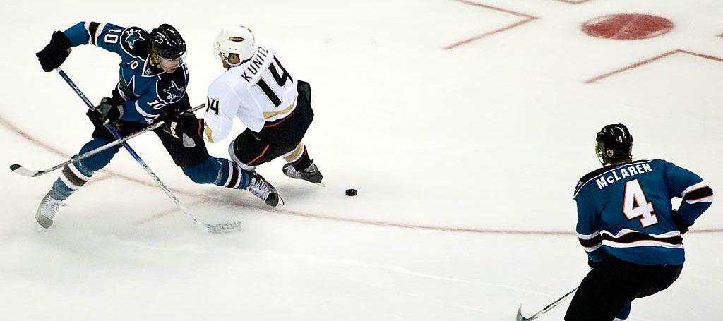 Christian Ehrhoff takes out Chris Kunitz during San Jose Sharks vs. Anaheim Ducks.
