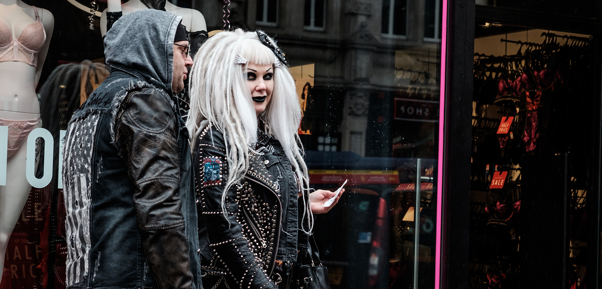 Adults in goth attire.