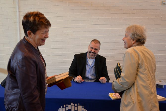 2019 Omaha Reads author Ted Genoways signing books at The Durham Museum