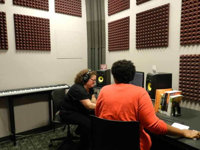 Two people working in the Creative Experience Recording Room