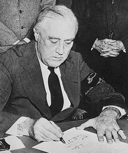 "FDR signing his ""Infamy"" speech"