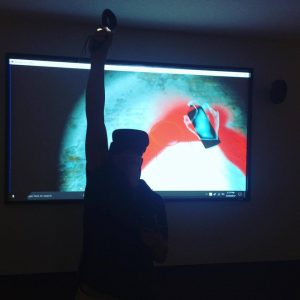 A patron painting graffiti in virtual reality