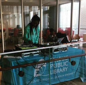 DJ Kimmie Nu spinning records