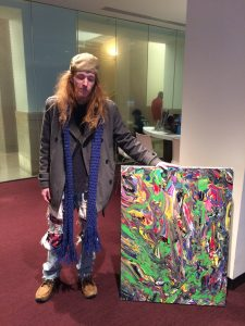 "Jacob holding a colorful abstract painting, acrylic on canvass 30""x40"""