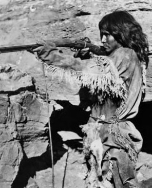 Paiute Indian firing a rifle (collection of Utah.gov)