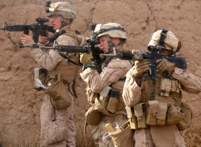 Marines returning small arms fire (Defense.gov photo)