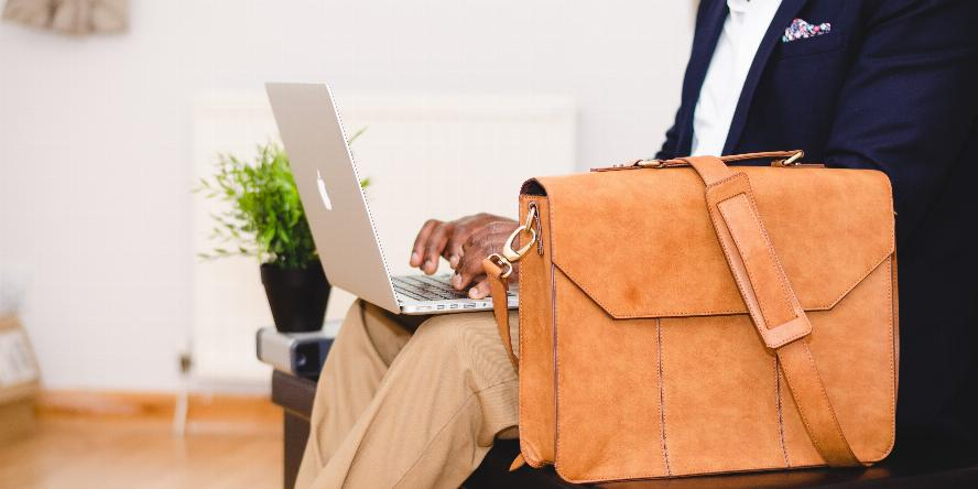 Photo of man with briefcase and laptop