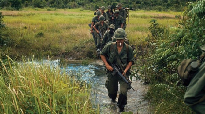 Soldiers crossing a field in Vietnam (Archives.gov photo)