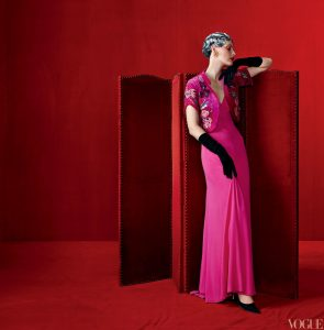 dress by Elsa Schiaparelli in her signature color, shocking pink.