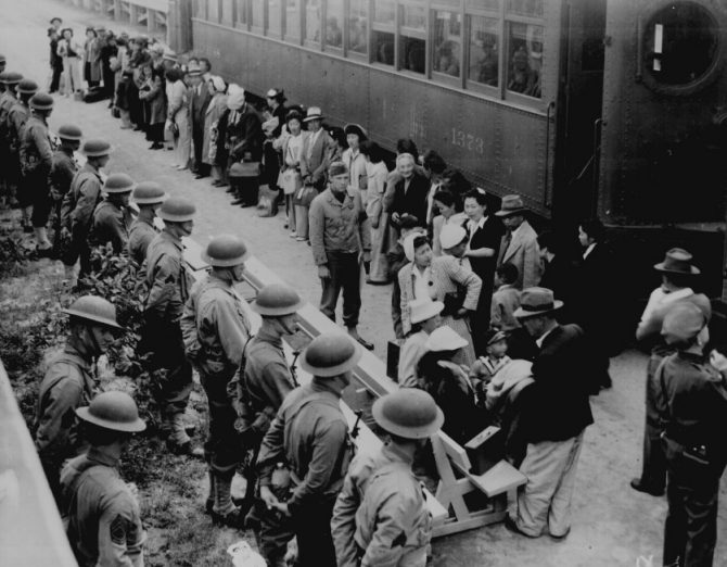 Japanese Americans boarding train to internment camp (NARA.gov photo)