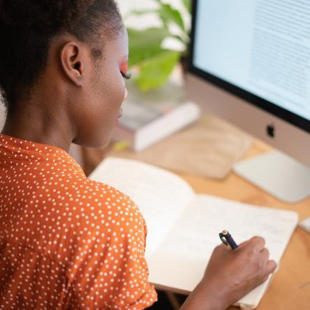 Teen girl studies at computer