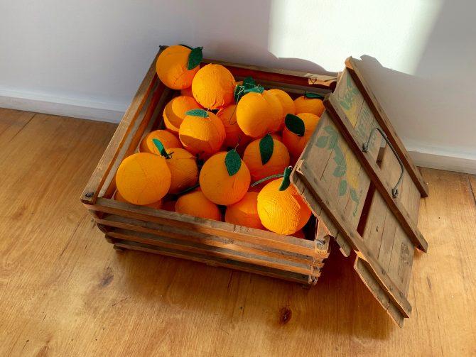 Title: Gift Medium: Papier mache, felt, wire, paint, vintage Florida citrus crate Date: 2019