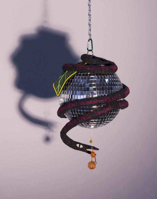 Title: PLEASURE Medium: Disco ball, felt, thread, glass beads, wire, carabiner, chain Date: 2020