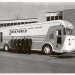 men standing by bookmobile