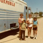 kids standing by bookmobile