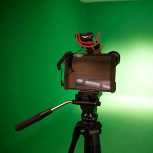 camera in front of a green screen