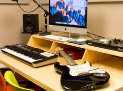 recording studio with keyboard microphone and guitar
