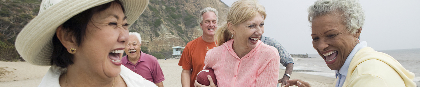 seniors playing football on beach