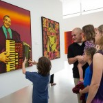 Patrons look at images in art gallery