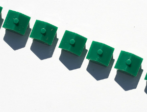 Monopoly game piece houses in row