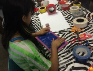girl working on craft