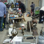 vendors selling wares, like lamps, small appliances, and other sundries.