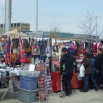 shoppers look at colorful bags and socks